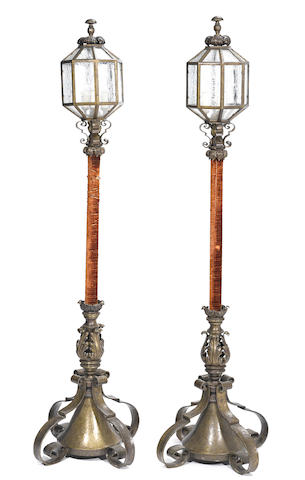 A pair of Continental Baroque style bronze, tôle and velvet floor lamps
