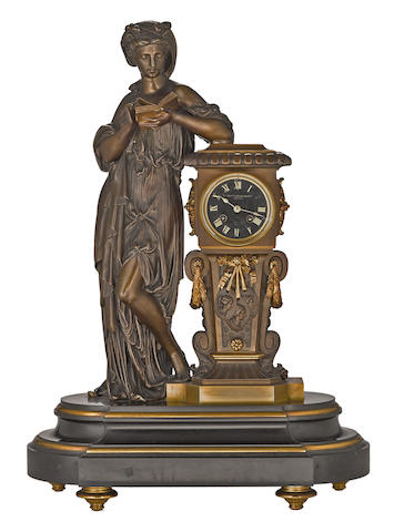 A French patinated, gilt bronze and black slate figural mantel clock