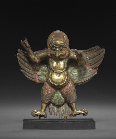A polychromed gilt copper alloy figure of Garuda