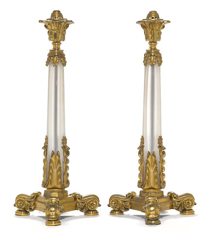 A pair of French gilt bronze mounted glass oil lamp standards