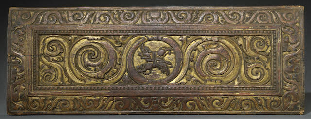 A gilt lacquered wood manuscript cover
