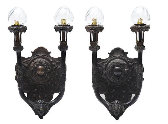 A pair of patinated bronze two light wall sconces in the Art Nouveau taste