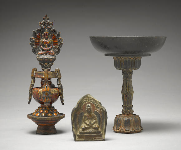 A clay tsa-tsa and two wood altar items