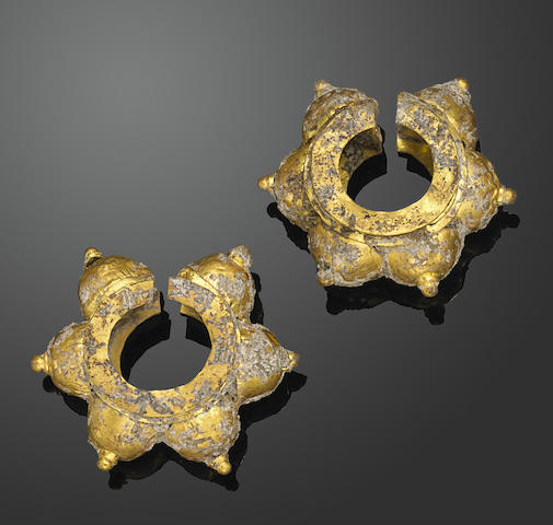 A pair of gold Champa earrings