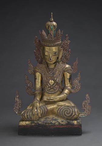 A large gilt wood Jambupati Buddha