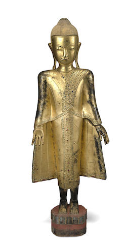 A gilt dry lacquer standing Buddha