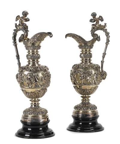 A pair of Continental Renaissance style silvered bronze ewers
