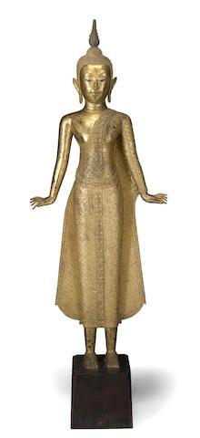 A Thai gilt metal figure of Buddha