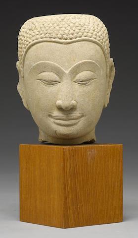 A Thai Ayuttaya-style stone head of Buddha