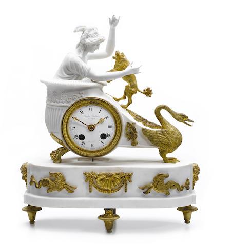 An Empire style gilt bronze mounted bisque porcelain mantel clock