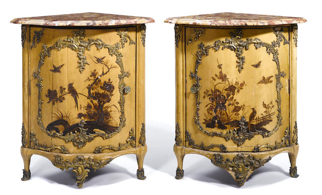 A pair of Continental Rococo gilt bronze mounted paint decorated lacquered corner cupboards