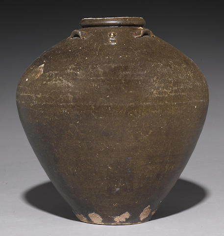 A large Thai brown glazed ceramic jar