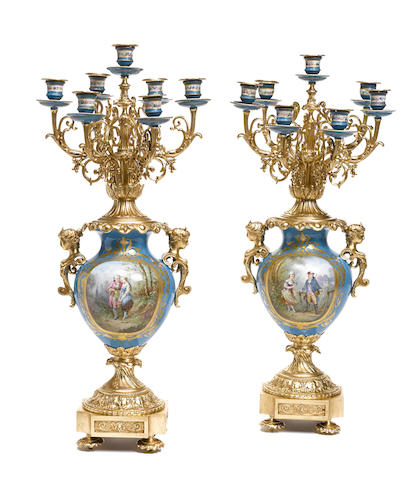 A pair of French gilt bronze and porcelain seven light candelabra