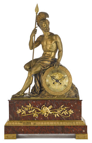 A French gilt bronze and rouge marble figural mantel clock