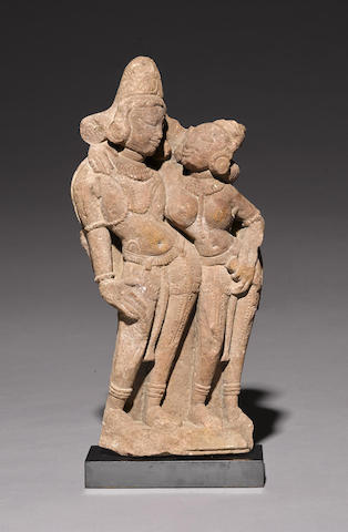 A sandstone stele with mithuna