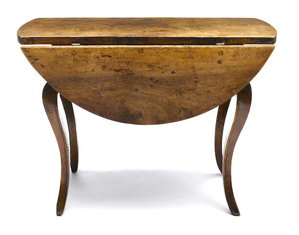 An Italian Rococo walnut drop leaf table