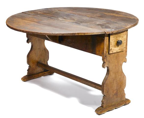 An Iberian Baroque walnut drop leaf dining table