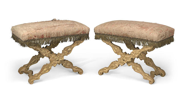 A pair of Italian Baroque style carved giltwood stools