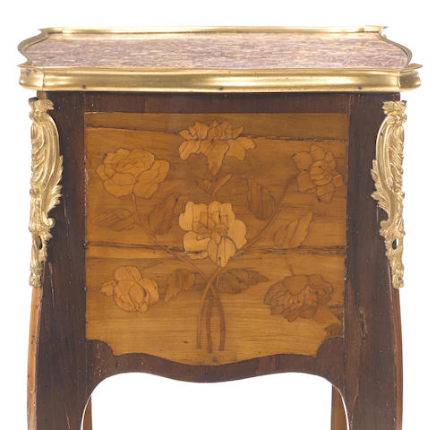 A Louis XV gilt bronze mounted marquetry and parquetry table en chiffonière