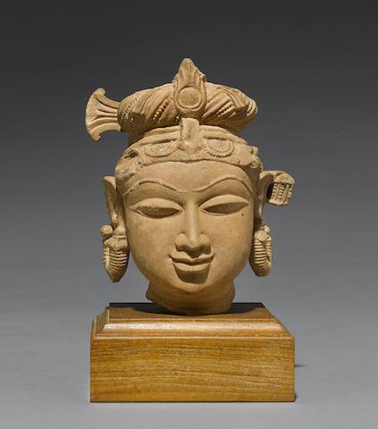 A sandstone head of a female figure