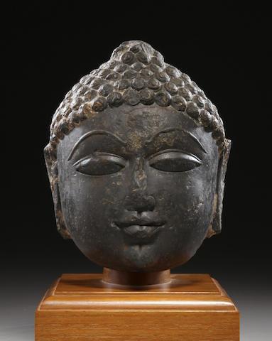 A black marble head of a Jina