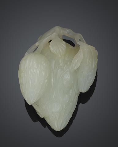 A carved jade fruit-form toggle