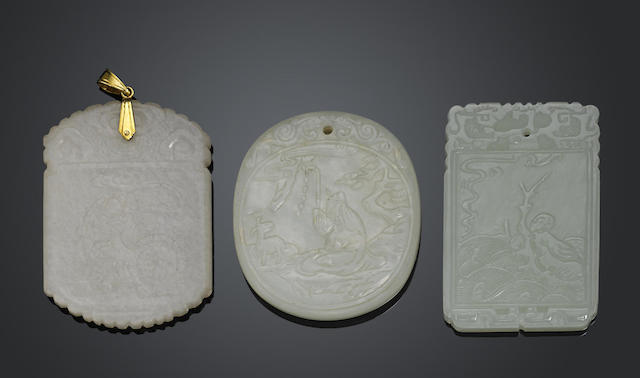 A group of three carved white jade plaques