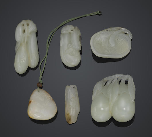 A group of six small white jade carvings