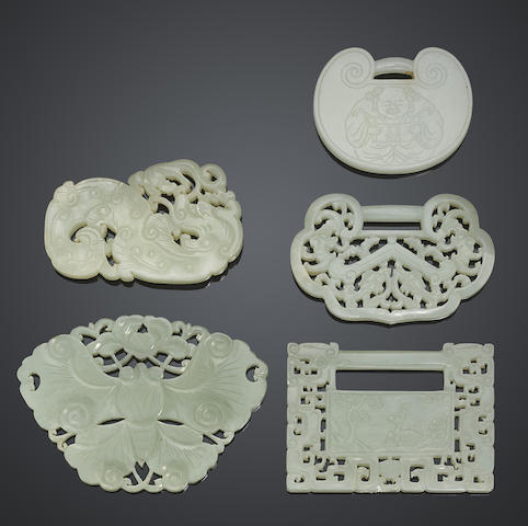 A group of five white jade amulets