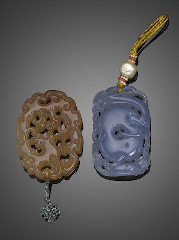 Two reticulated hardstone plaques