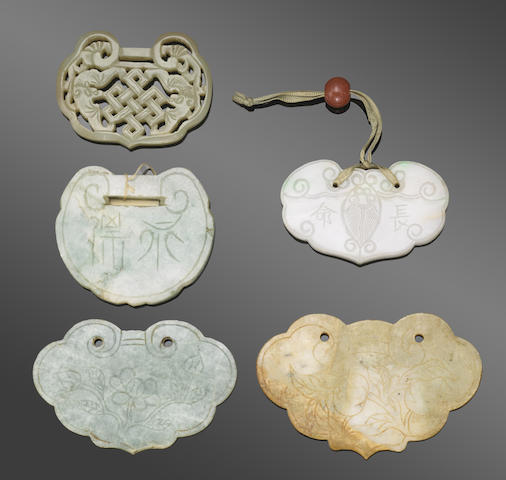 A group of five jade plaques of ruyi lappet form