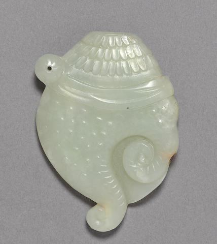 A carved jade toggle
