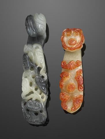 Two carved jade belt buckles