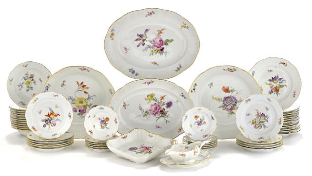 A Meissen porcelain floral decorated and Altozier molded dinner service