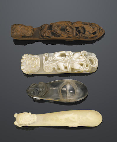 A group of four belt buckles