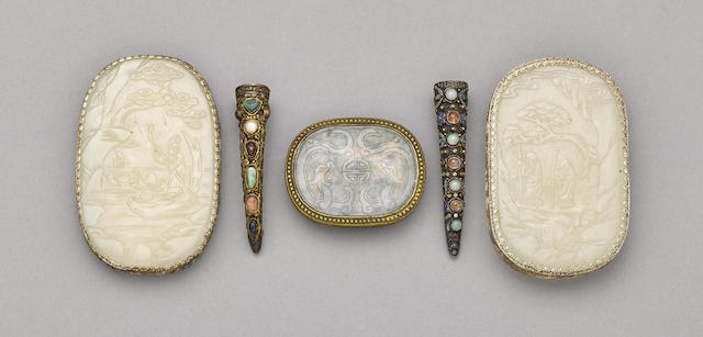 A group of three jade plaques and two fingernail guards