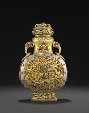 A gilt silver lidded moon flask
