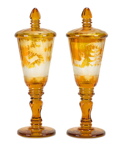 A pair of Bohemian amber flashed glass pokals