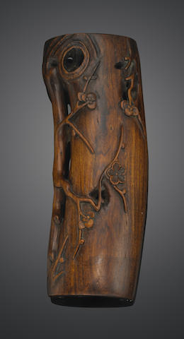 A carved hardwood wrist rest