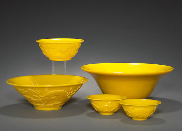 A group of five yellow glass bowls