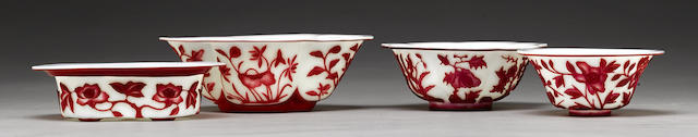 A group of white glass bowls with red overlay decoration