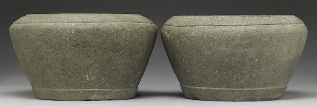 Two carved stone basins