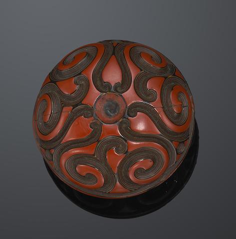A small tixi lacquer box