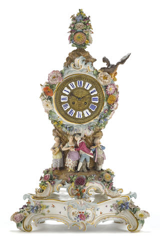 A Meissen porcelain figural and floral encrusted clock on a stand