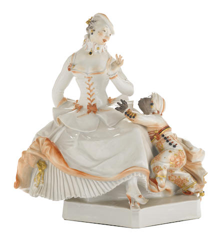 A Meissen porcelain group of a lady and moor