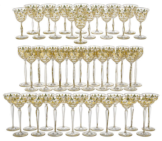 A suite of Continental engraved and gilt decorated stemware