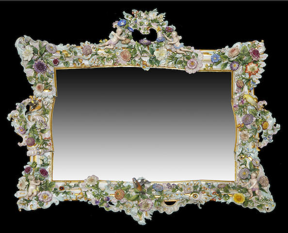 A large Meissen porcelain figural and floral encrusted mirror