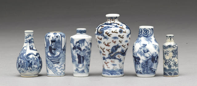 A group of six miniature blue and white snuff bottles and vases
