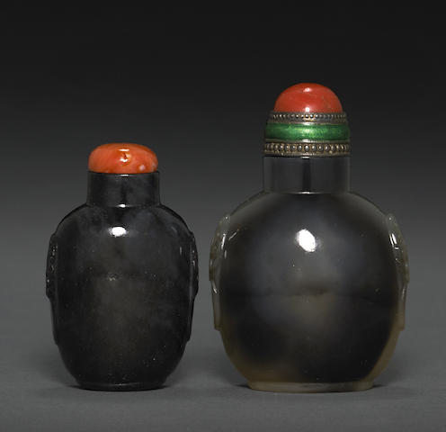 Two dark colored stone snuff bottles