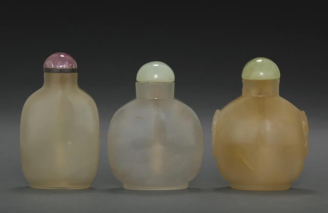 A group of three caramel agate snuff bottles